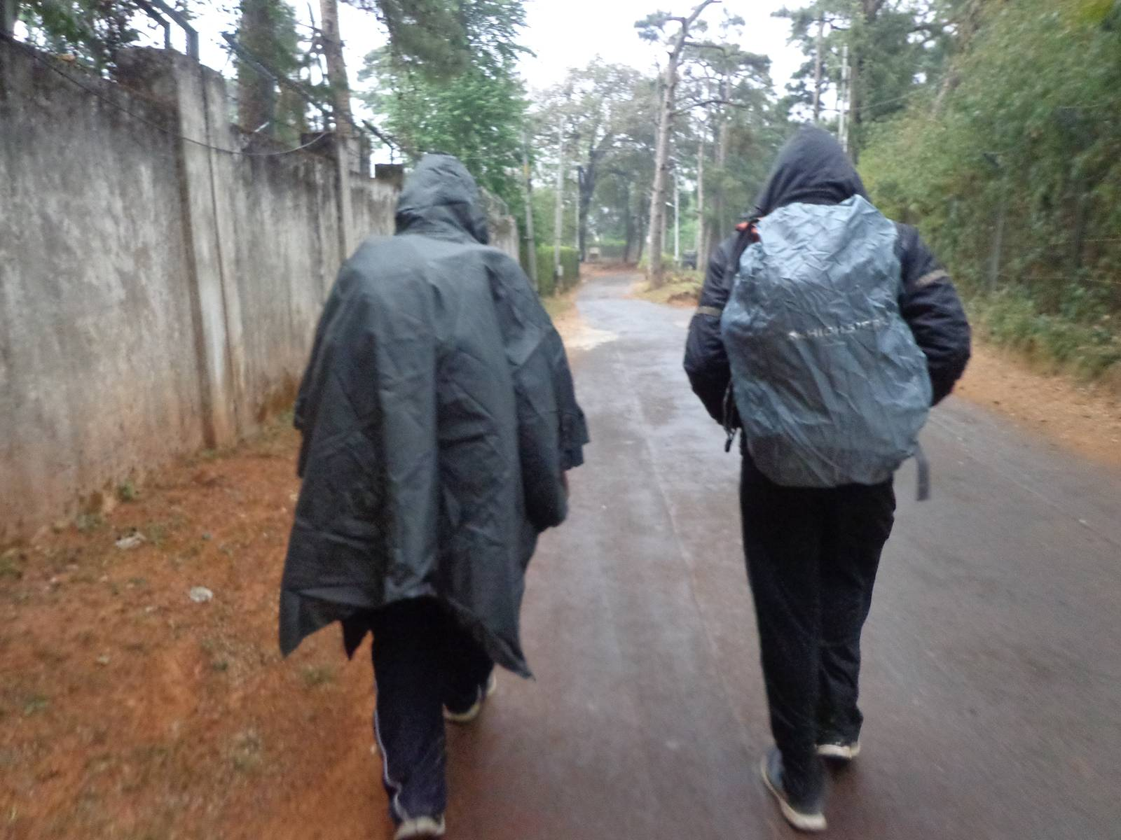 Nandy and Gowri Sankar with their rainwears on.