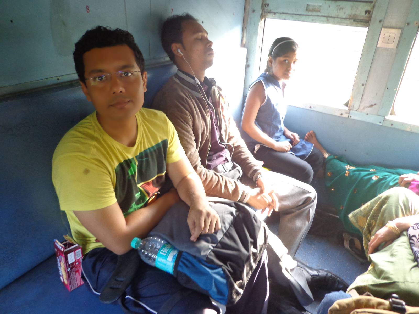 Nandy with fellow passengers. The small girl was reading an Assamese to English wordlist.