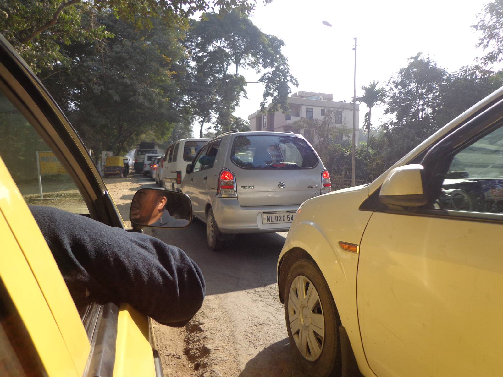 A bumper to bumper jab in Dimapur. Our taxi driver had already pulled the cab into the dirt pavement.