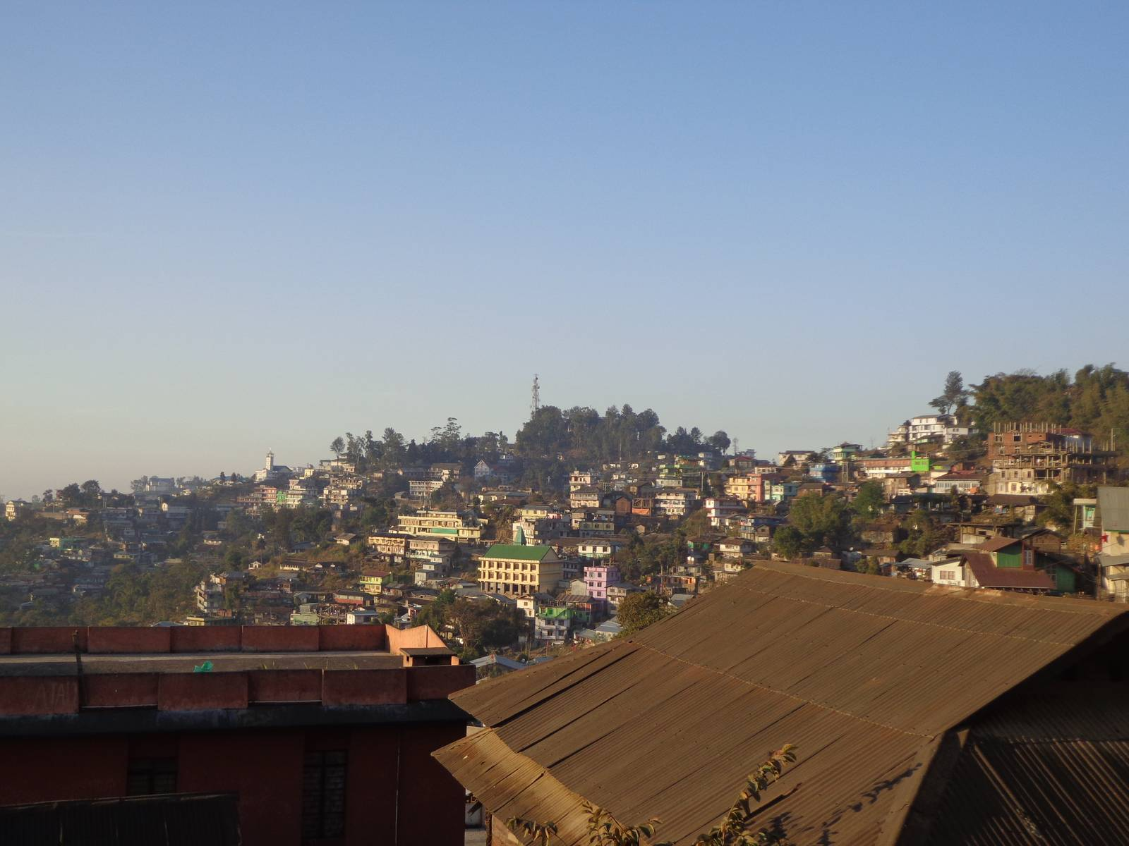 I have a cheap point and shoot. This shot of Kohima from a moving vehicle doesn't do justice.
