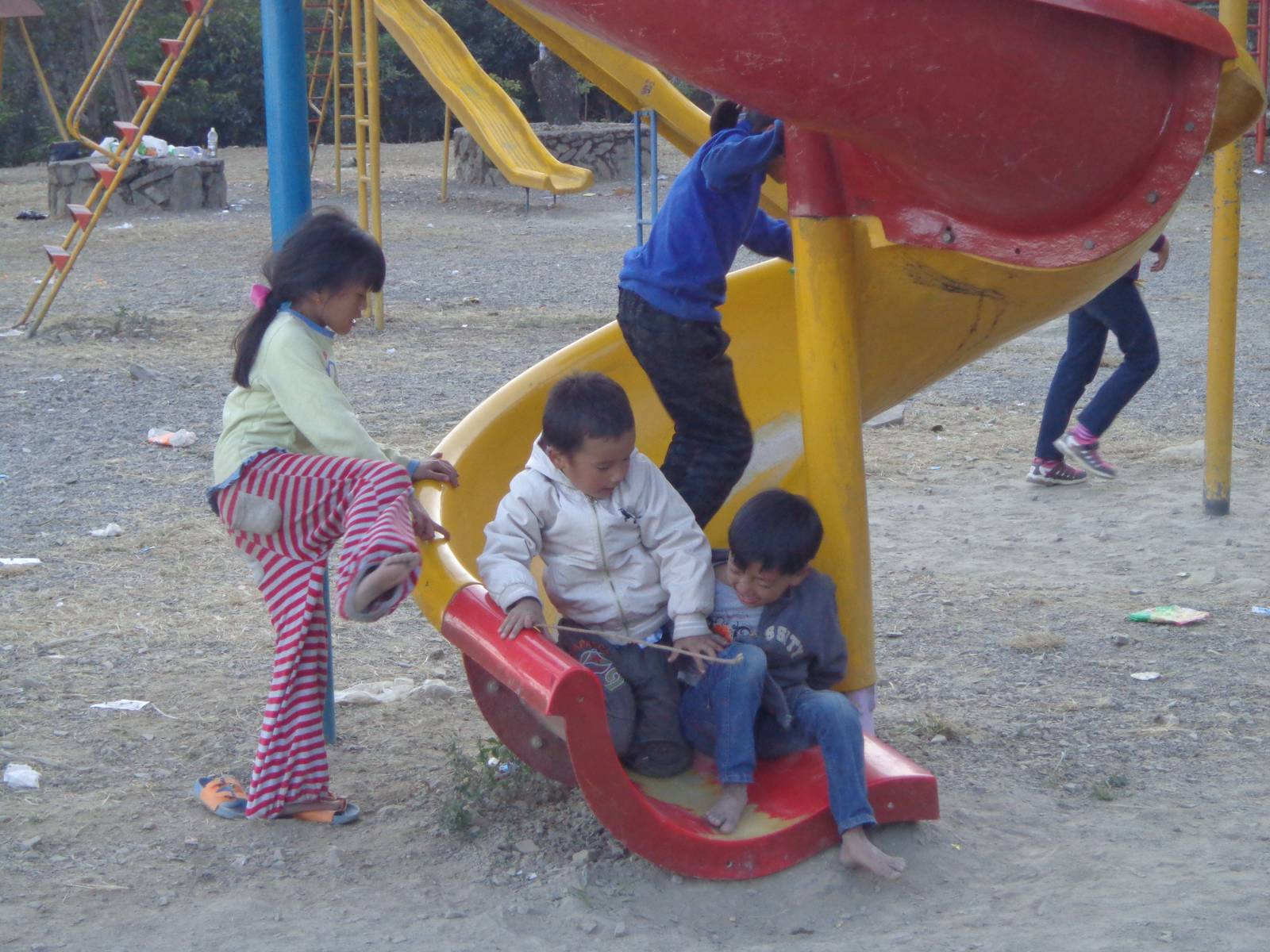 Kids playing at the small playground inside Kisama village