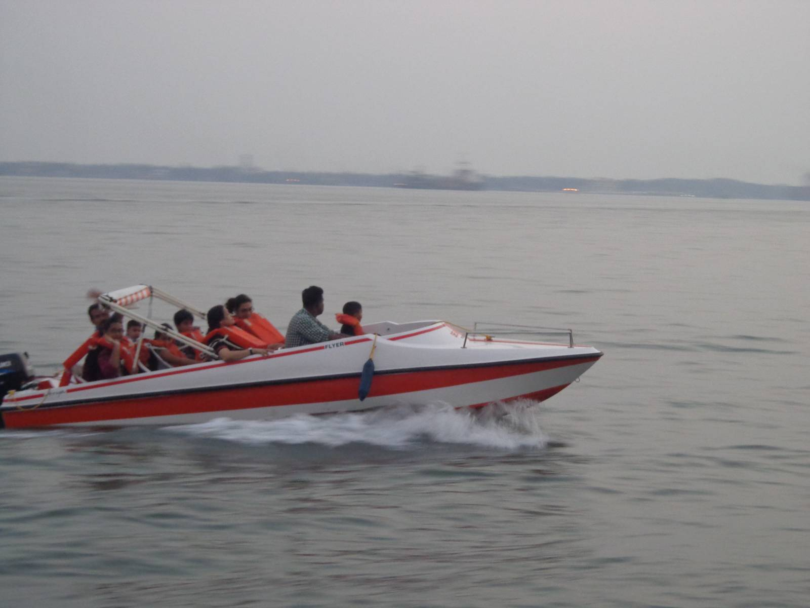 A speedboat zoomed past our slow ferry.