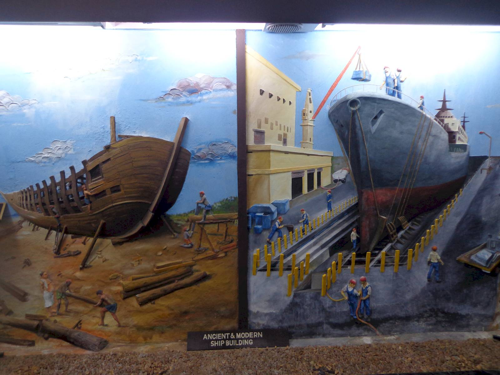 A relief comparing medieval and modern shipbuilding methods in Calicut.