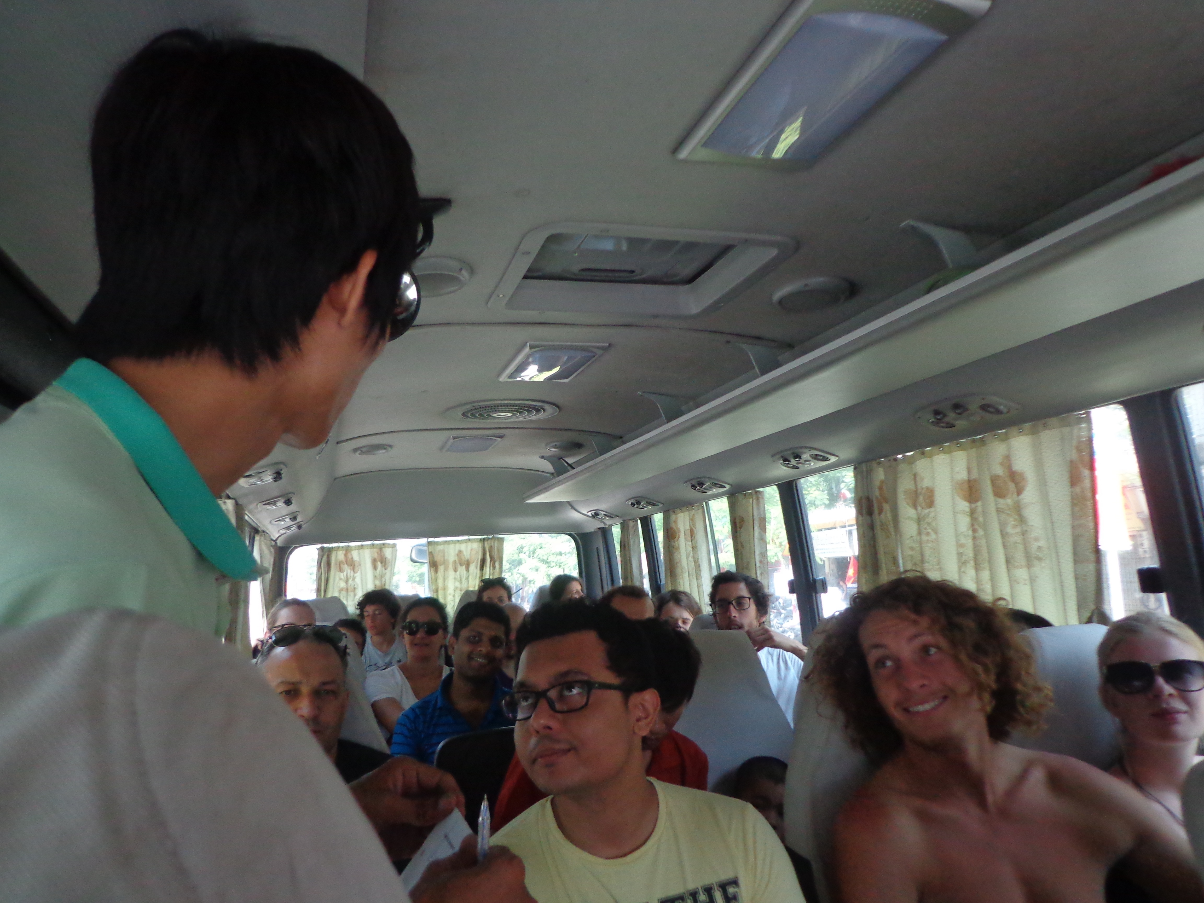Phuong, our guide introduces himself and the trip itinerary on bus.