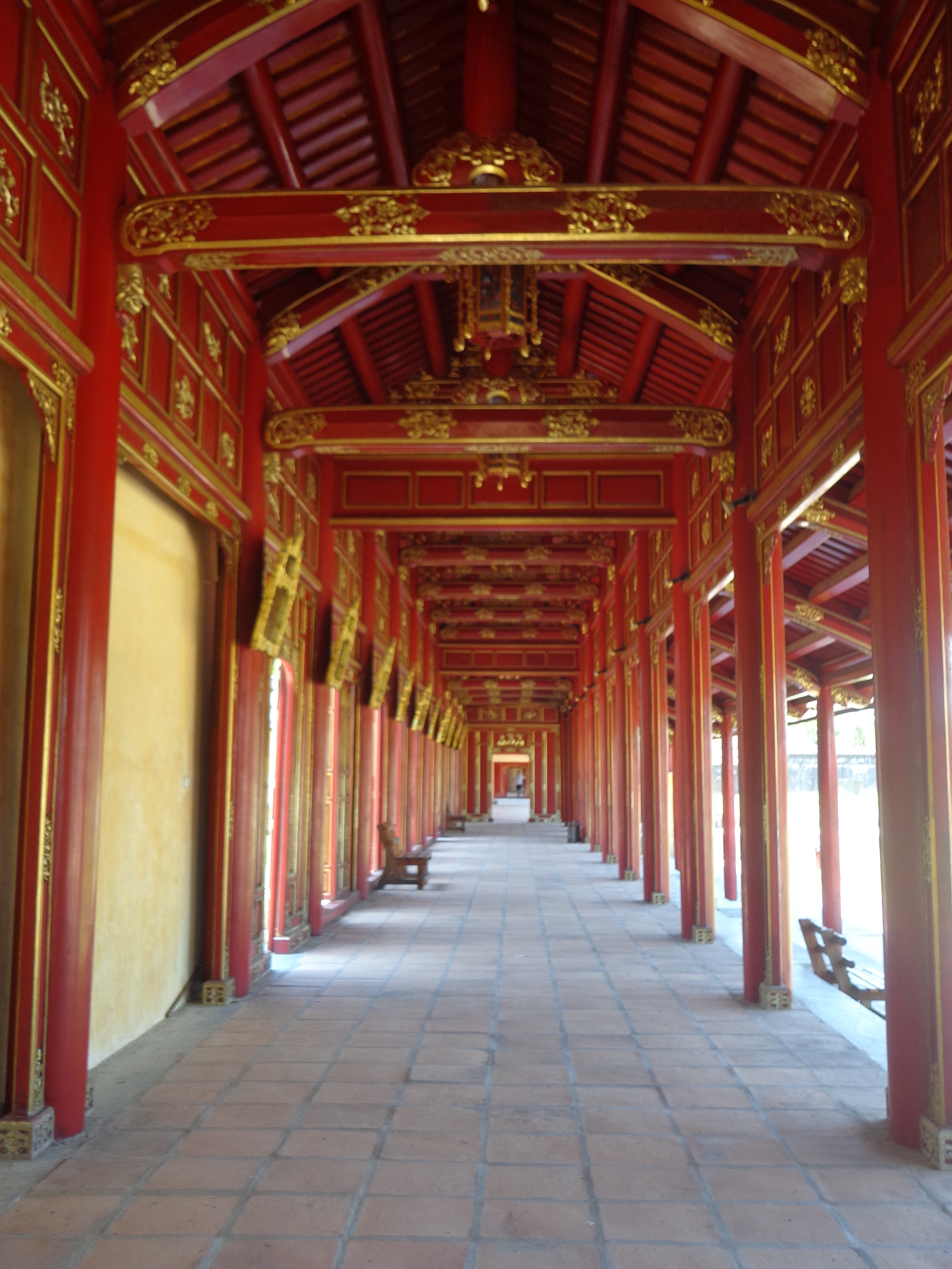 The corridors joining various parts of the palace , temples and shrines are decorated in red and gold.