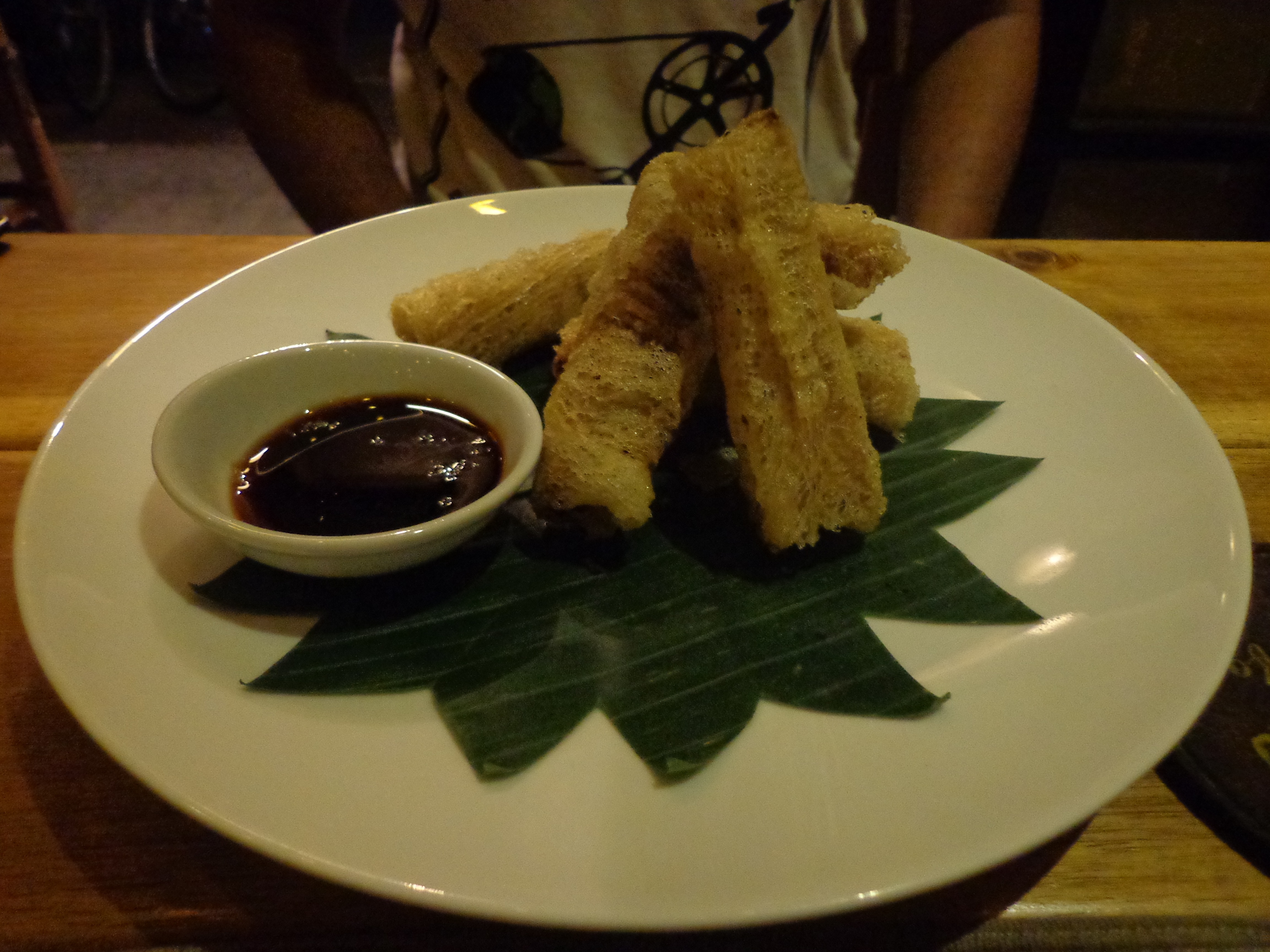 Nandy liked the duck spring rolls on the platter so much that he ordered an entire portion of it.