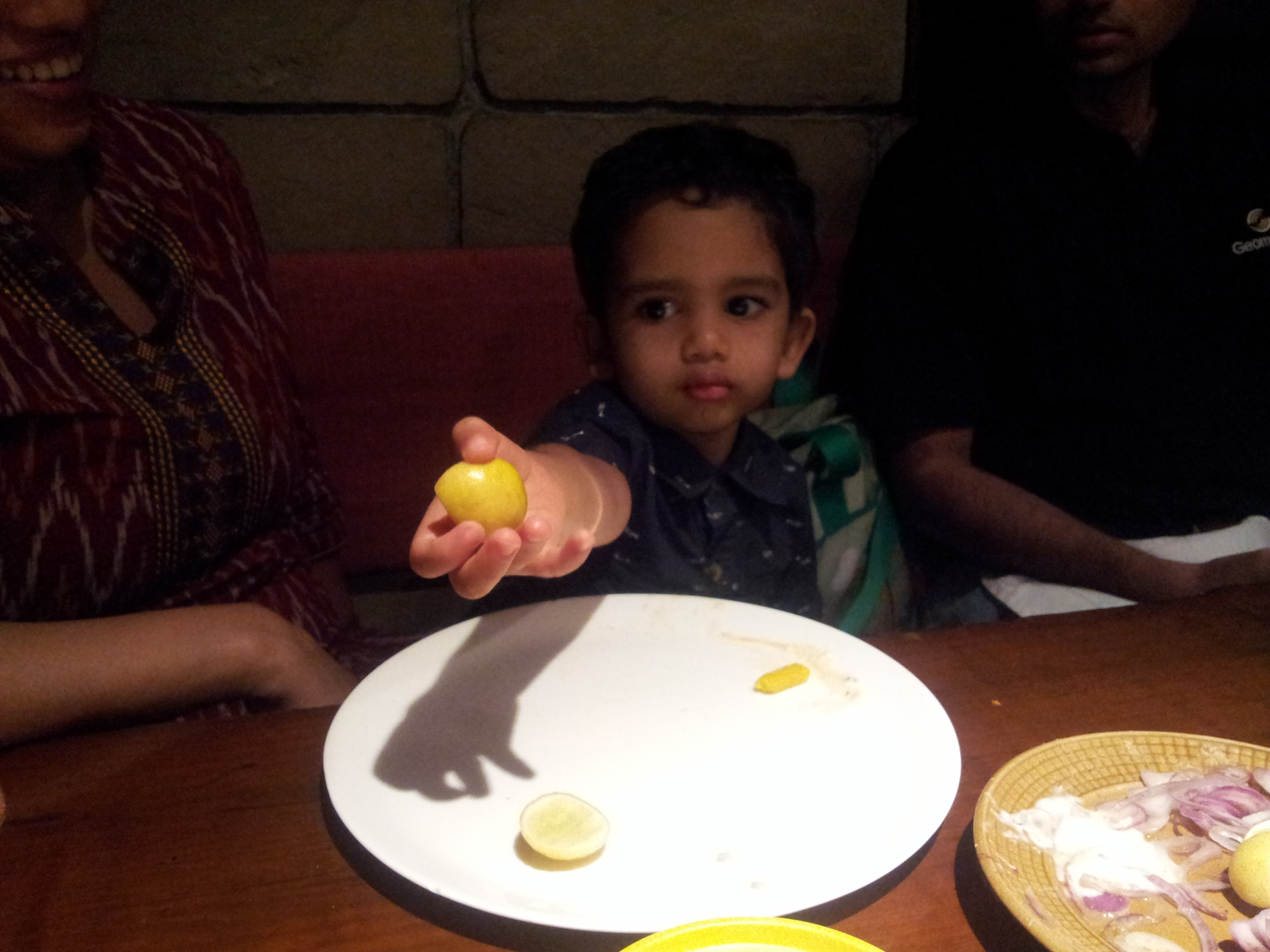 Rehaan giving me a slice of lemon.