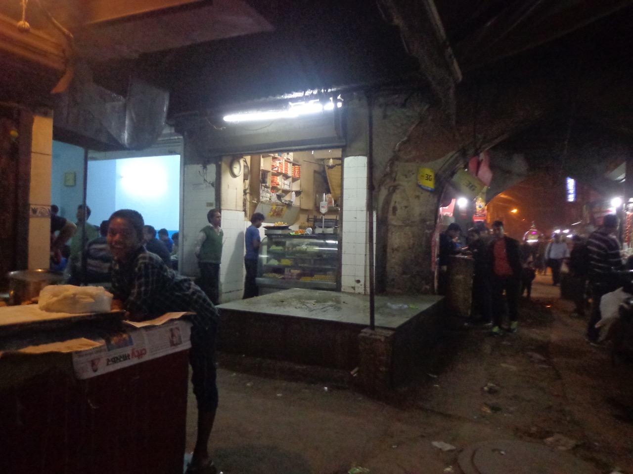 The shop making roti owns the area opposite to it. That's the seating place.