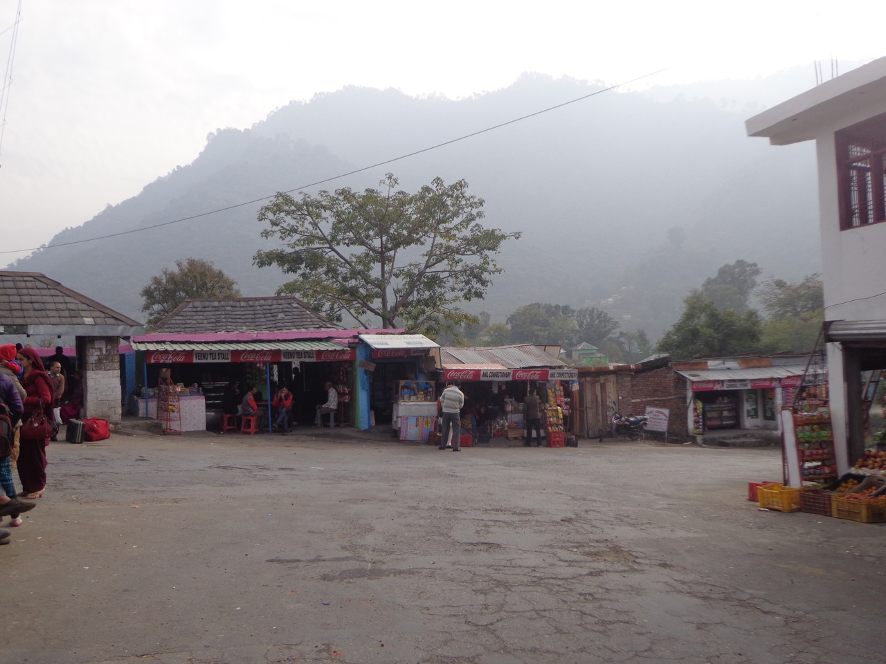 Lahru has only a handful of shops. The foggy mountains make a picturesque background.