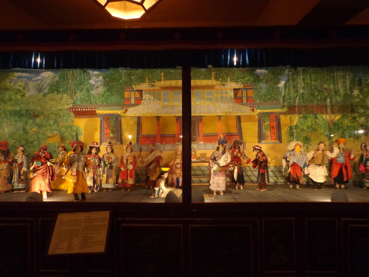 This is a scene from Lhamo Opera. Such operas were introduced by an 11th century saint, Tangton Gyalpo, in order to raise funds for building bridges. Later, the most elaborate of these became day long events.