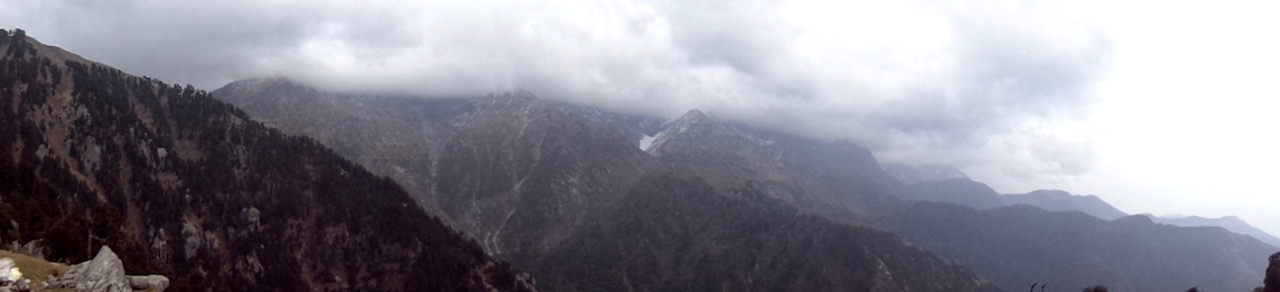 A panorama of the Dhauladhar range from Triund. Notice the clouds building up.