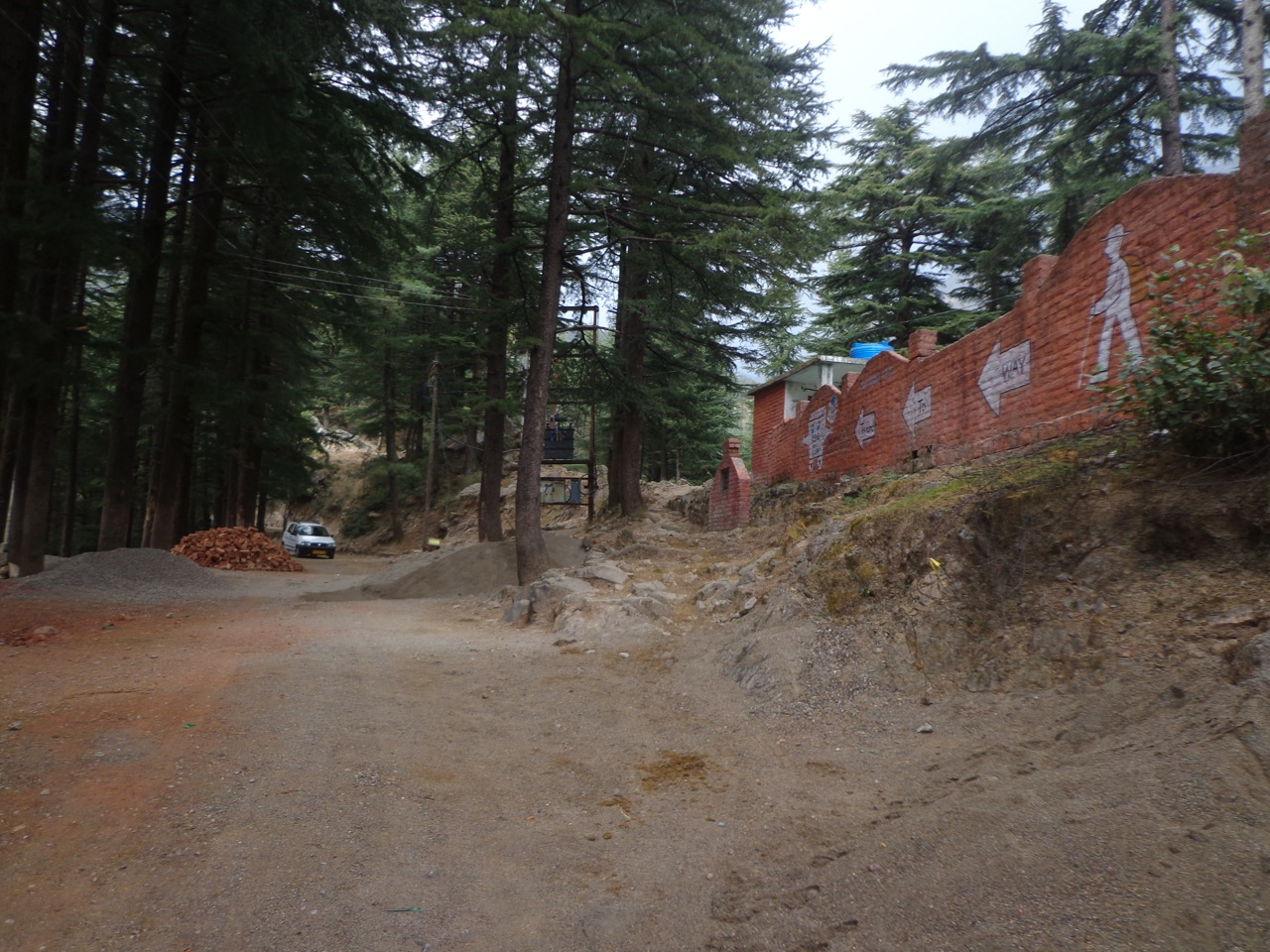 The walking trail to Triund is between the trees and the wall. I took the proper road instead.