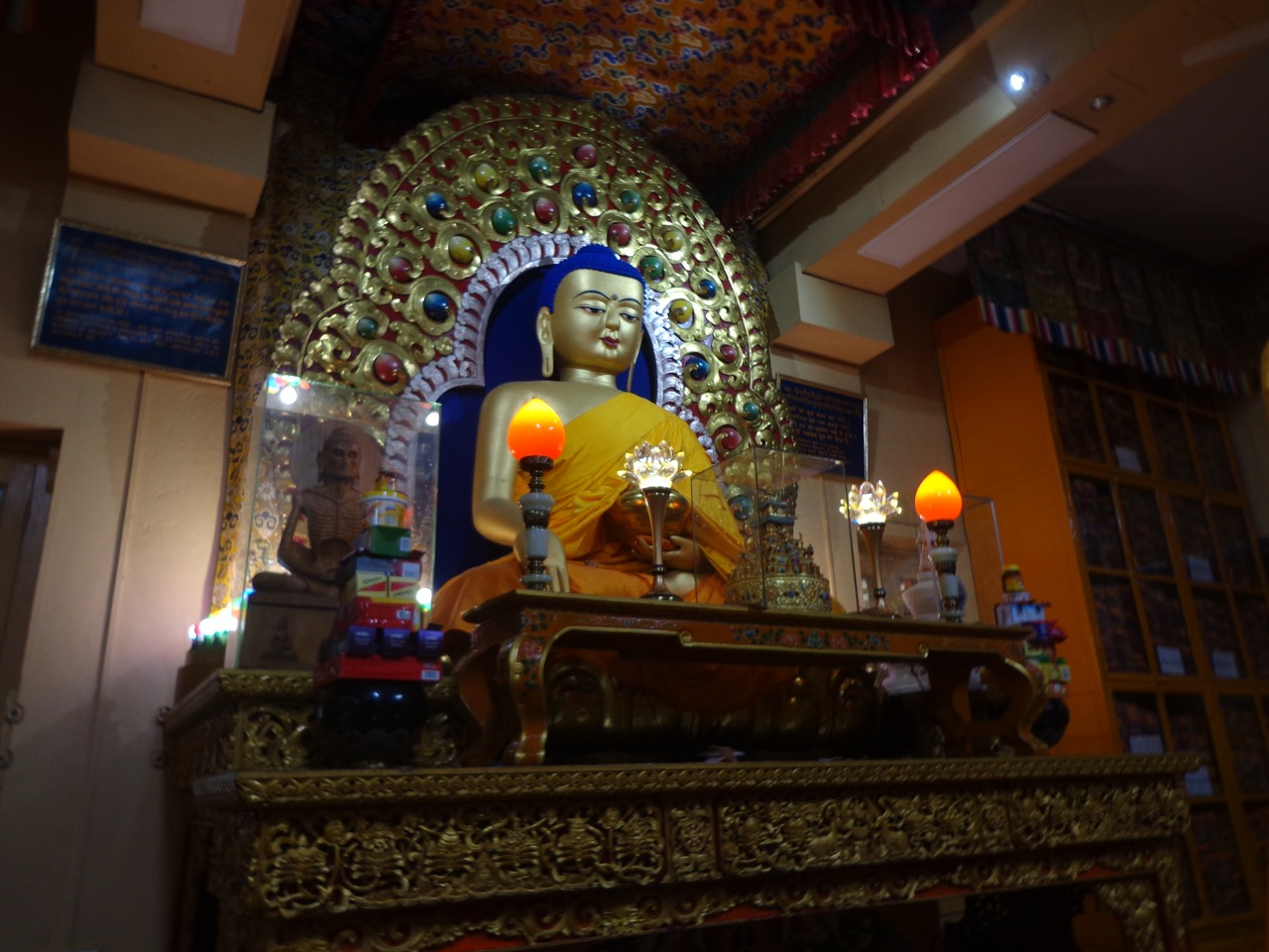 The Buddha statue of the temple. Some ancient scriptures are also preserved in this room.