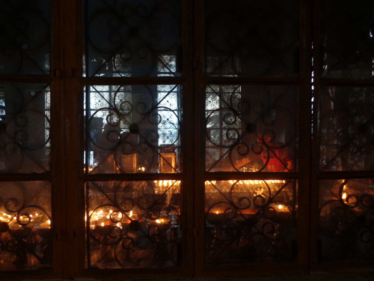 Monks lighting up butter lamps for offering.