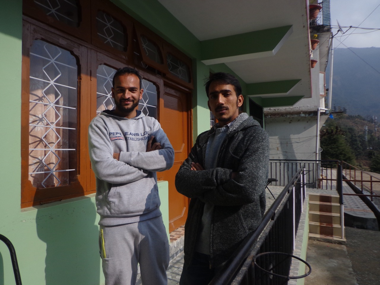 Vinay and Ganesh posing in front of the staff room of Backpackers Inn.