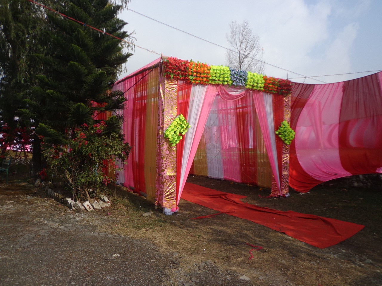 The marriage tent (pandal). Judging by the delay, the marriage would not occur before 12:00 in the night.