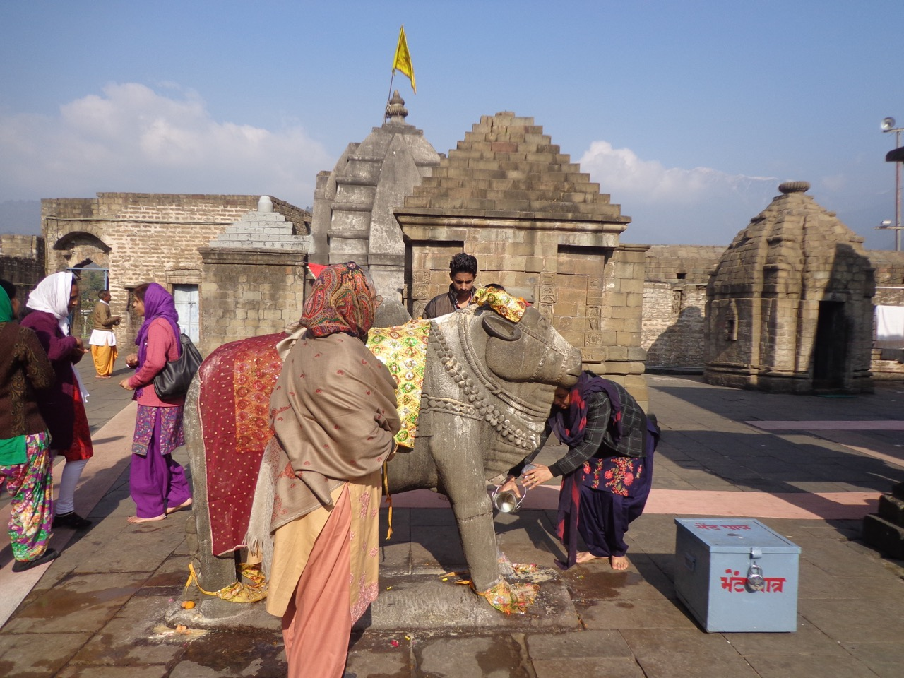 Devotees flocking to touch the bull (Nandi).