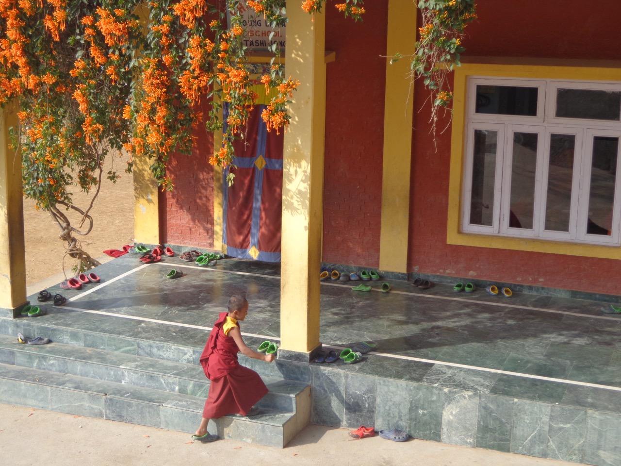 A young monk entering the Tashi Jong School.
