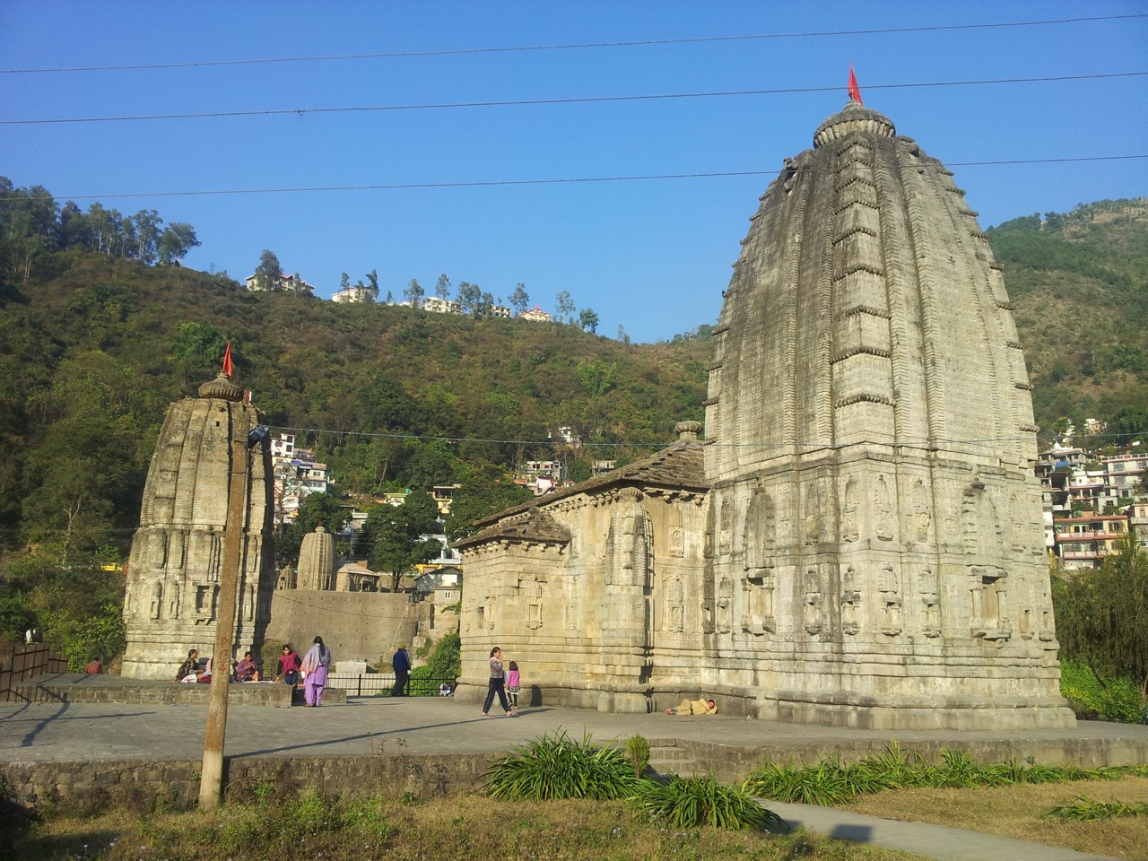 This is a Shiva temple just on the opposite bank of the Triloknath temple. Triloknath temple's spire is visible between the two spires.