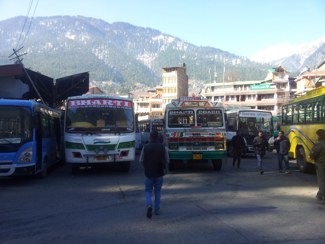 Manali bus stand with the great Himalayas in the background.