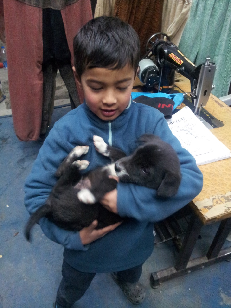 Anubhav with another puppy.