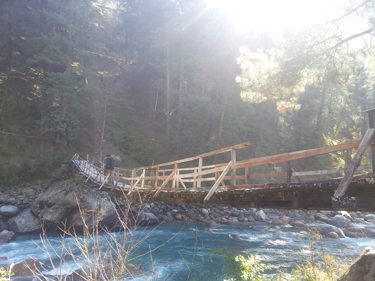 I crossed this wooden bridge and asked the two men for directions.
