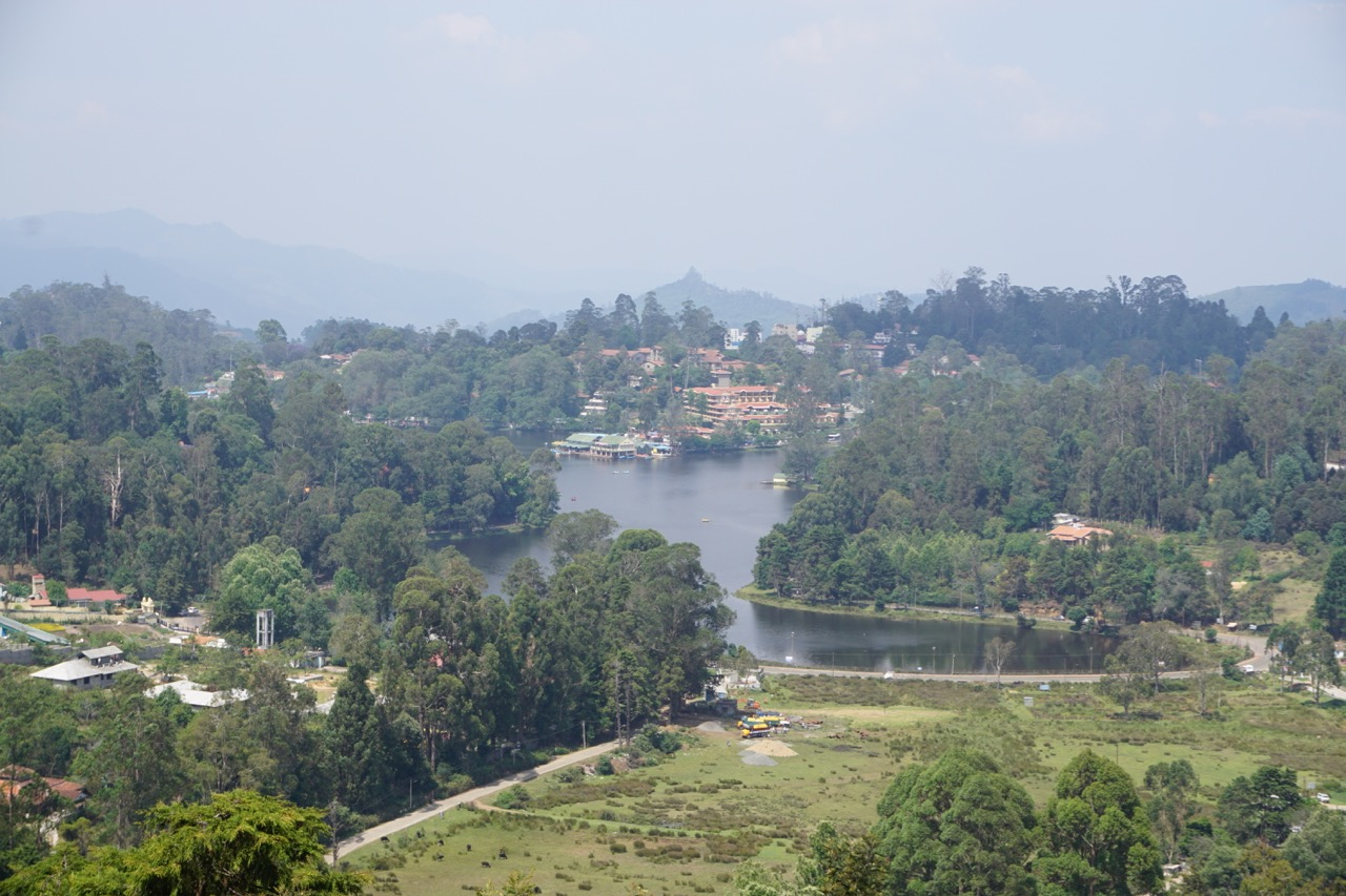 Upper Lake Road offers an unobstructed view of the Kodaikanal Lake. For 5 rupees, a person offers the lake's view through telescope. He claimed that the distance was 8 kms. The map clearly shows that the aerial distance is actually 2 kms.