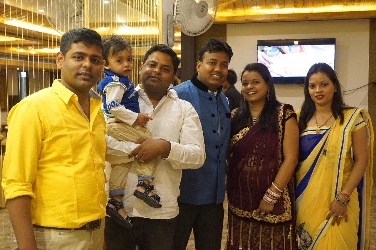 Nandan's family posing for a photograph.