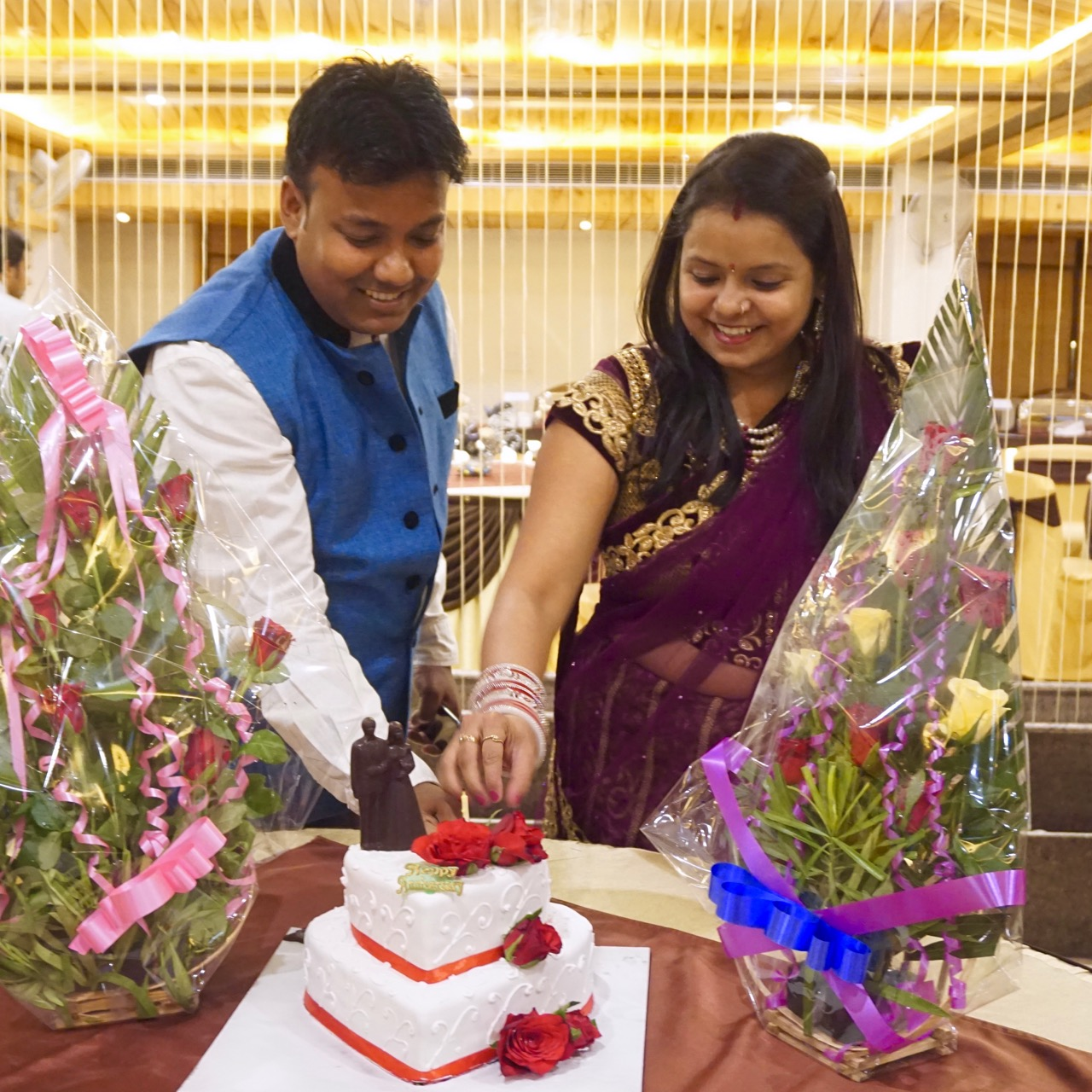 Nandan and his wife dissecting their anniversary cake.