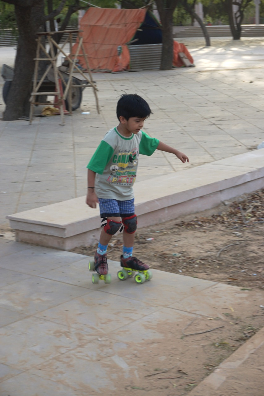 A kid practicing his skating.