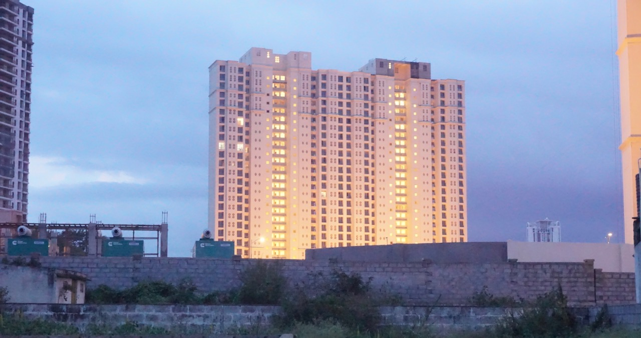 This is the Hiranandani tower, stone's throw away from Parth's house. High stakes, high rise buildings in a village!
