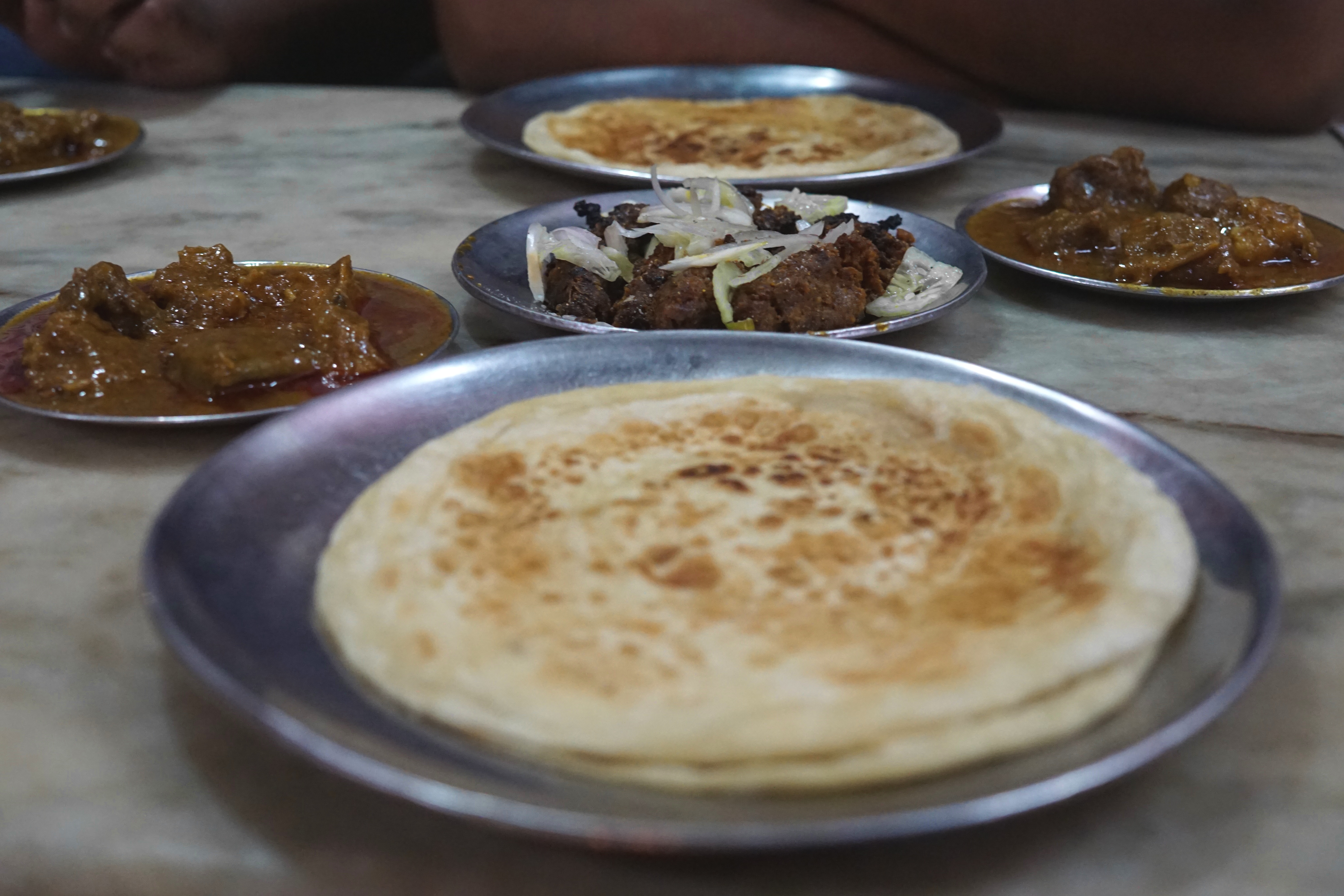 This is the food (bhuna paratha, beef curry and kebabs), and...